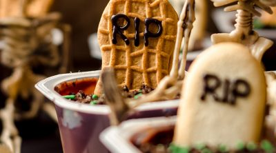 graveyard pudding cup with a skeleton sitting on it